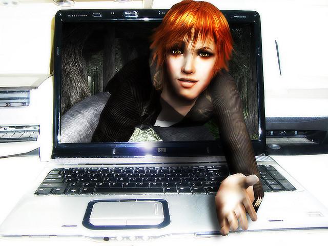 Bilde av en kvinne som ber deg komme inn i skjermen