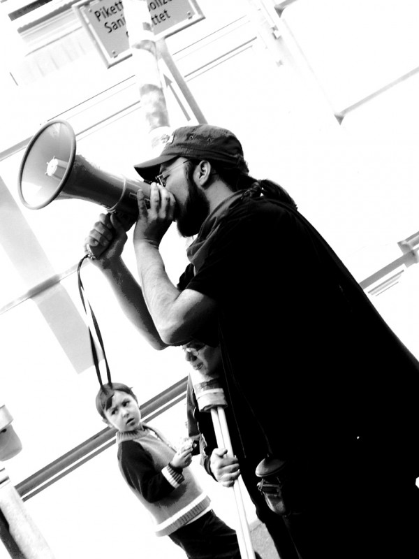 Man speaking into a megaphone.